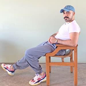 Al Alnajjar sitting in a chair
