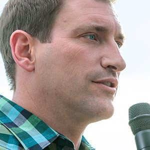 Josh Churlik Speaking at Microphone