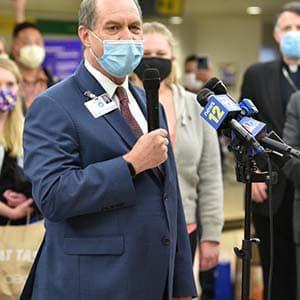 Kevin Slavin Speaking in Microphone to Colorado Nurses