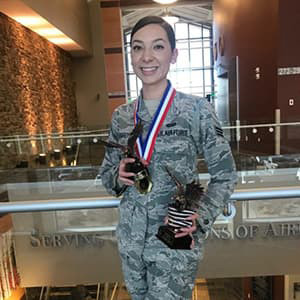 Staff Sgt. Manuella Tabares in uniform with awards